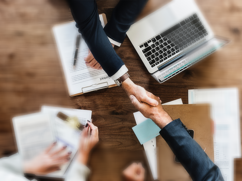 Photo of businessmen shaking hands over a SLA contract Photo by rawpixel.com from Pexels