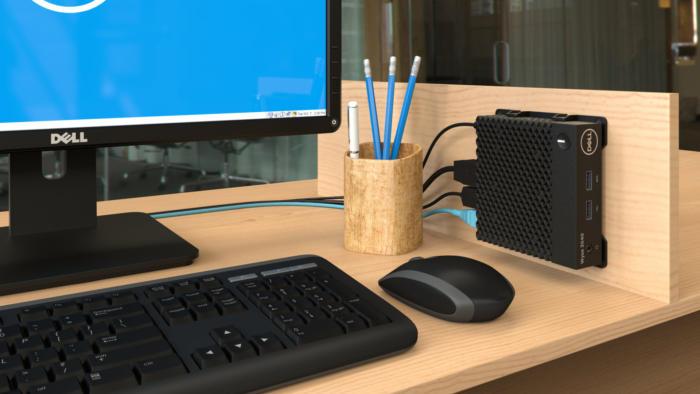foto van een kantoorwerkplek met een afbeelding van een Dell thin client computer